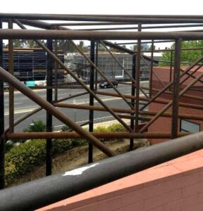 Structural steel rods installed and ready to support a two-level canopy.